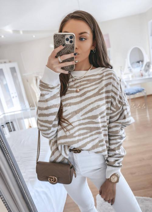 sweter w zebrowy wzór kremowy Slev