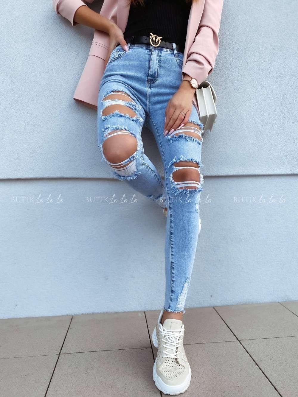 jeansy zdużymi dziurami