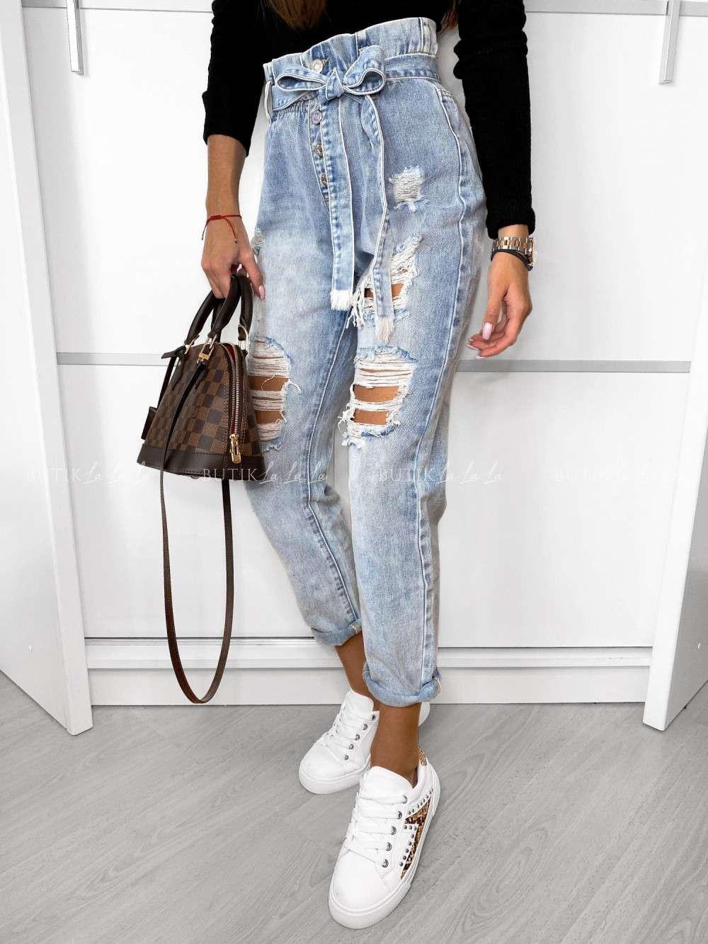 jasne jeansy zdziurami